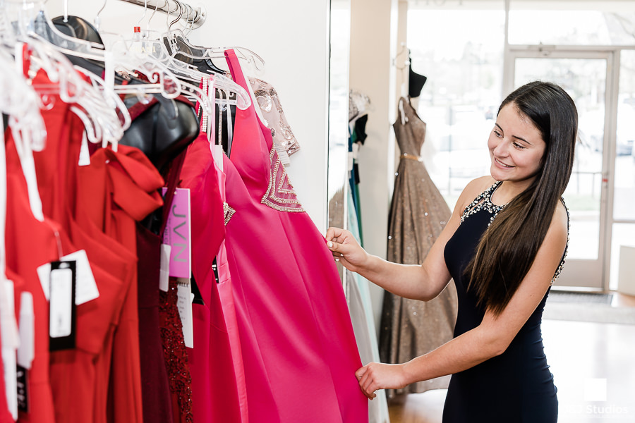A customer checks out the latest Terani Dresses at PromMiss Dresses.