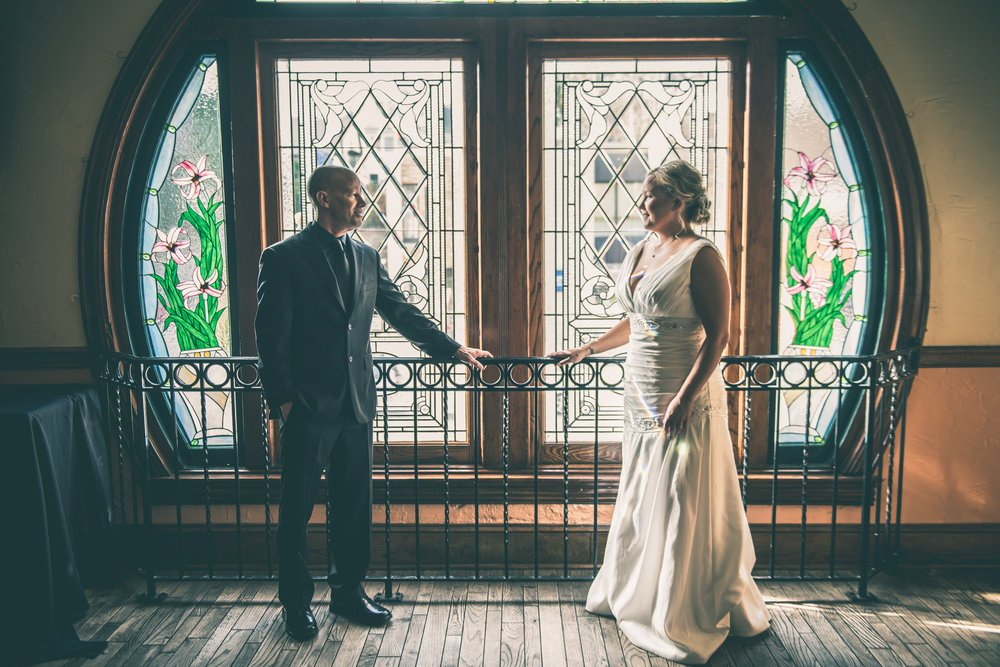 There ended up being gorgeous stained glass windows in the upstairs bar that were perfect for some couples photos and a few portraits.