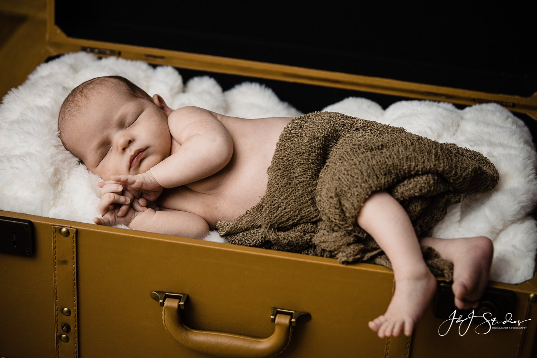 baby in suitcase newborn photographer