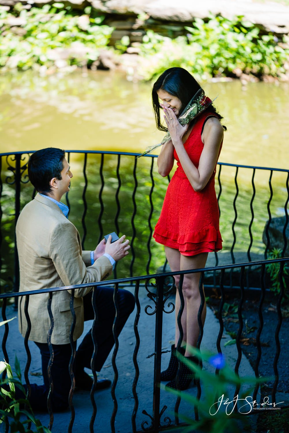 Surpise proposal engagement with ring kneeling down
