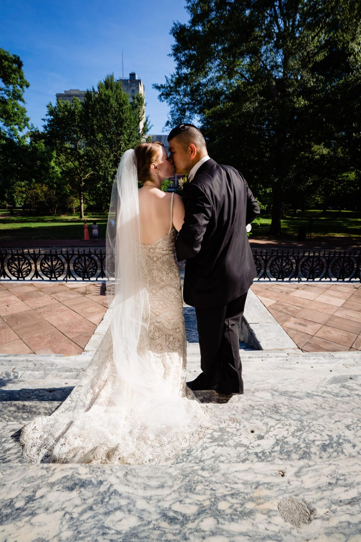 bride groom outside veil lace gown suit