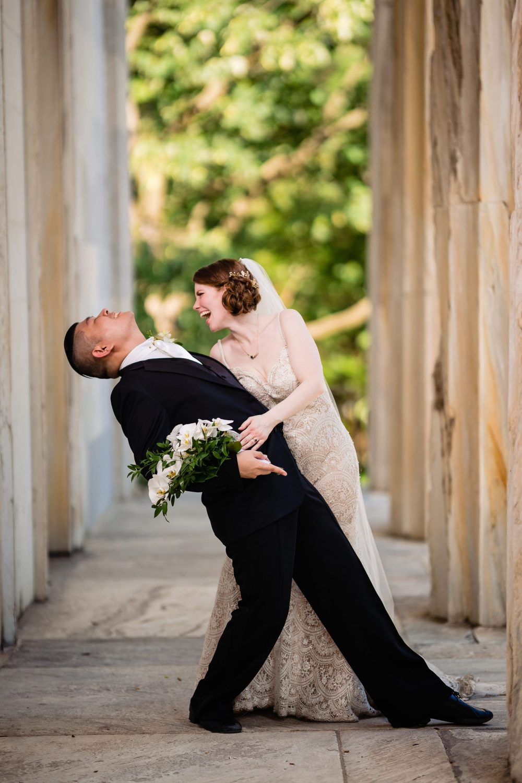 bride laughing dancing groom bouquet