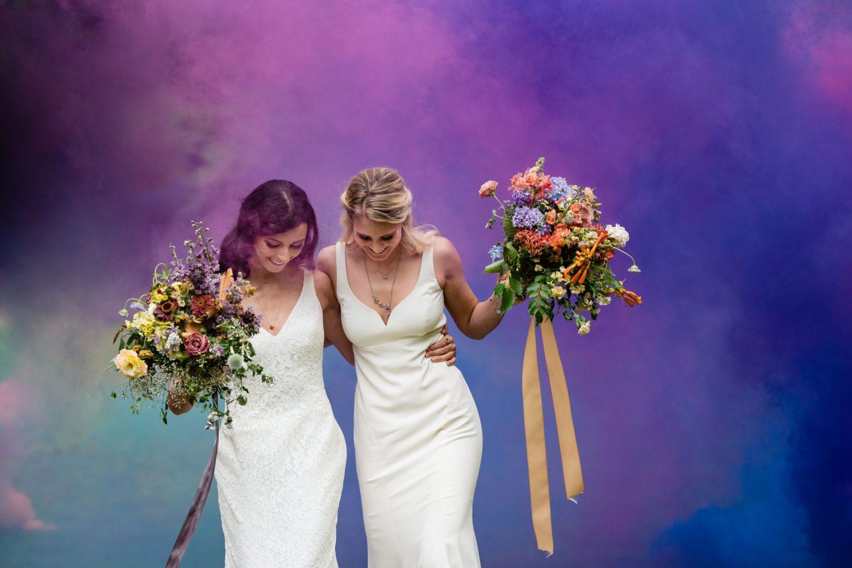 same sex couple rainbow smoke