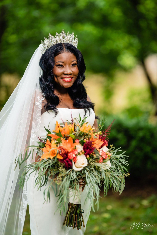 flowers bouquet wedding veil smiling bride