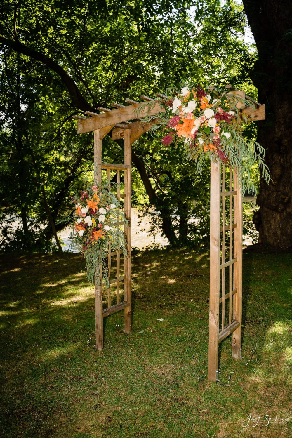 wooden archway with flowers PA