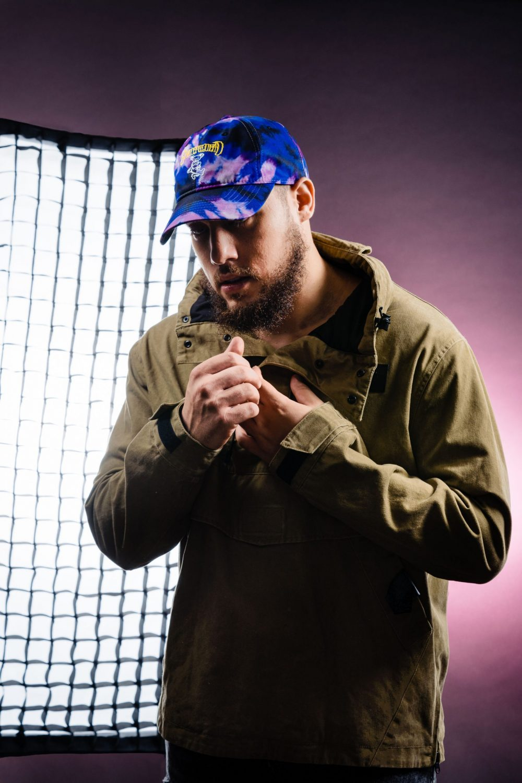 man blue hat jacket studio lights artist photography