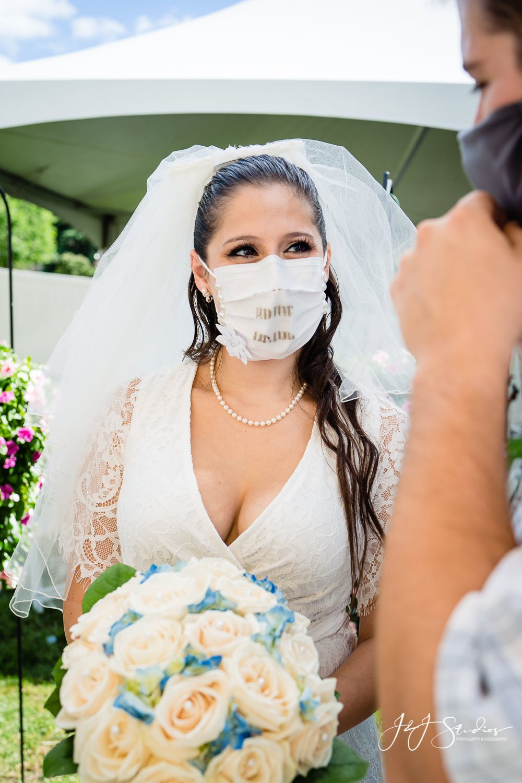 bride stunning in her mask