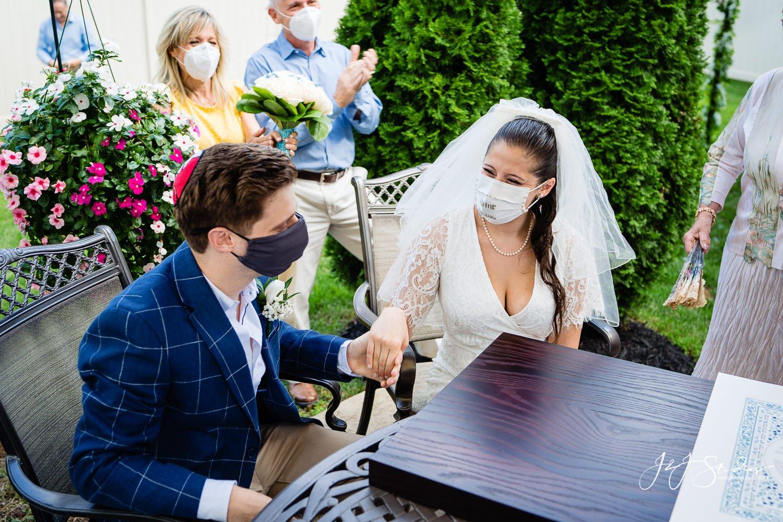 bride signs Ketubah
