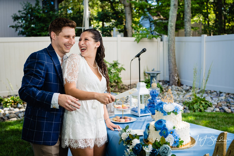 cutting the cake backyard wedding