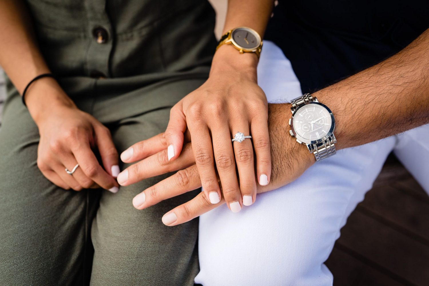 two watches white nail polish hands engagement ring