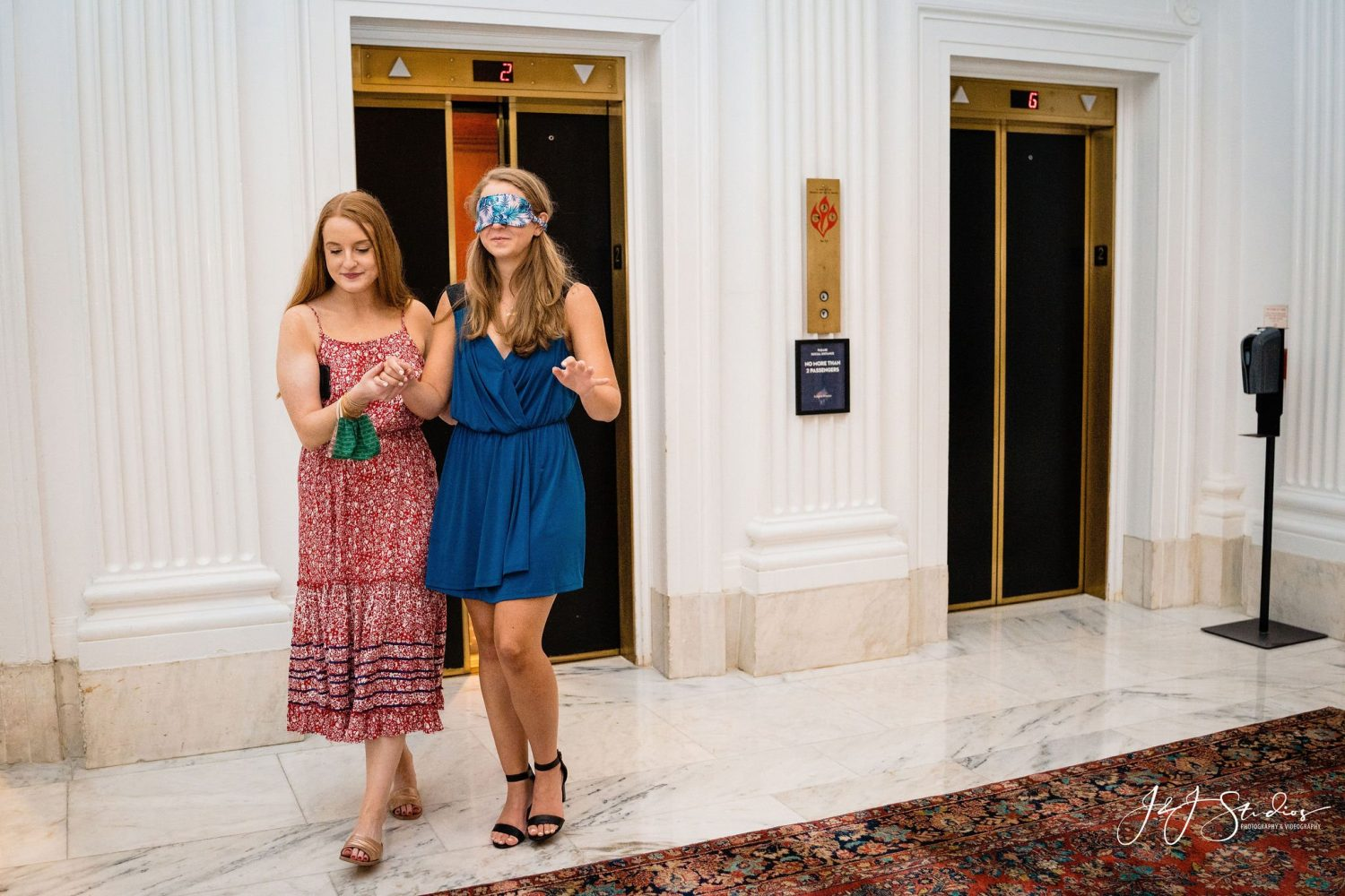 friend leading girl with blindfold cute dresses
