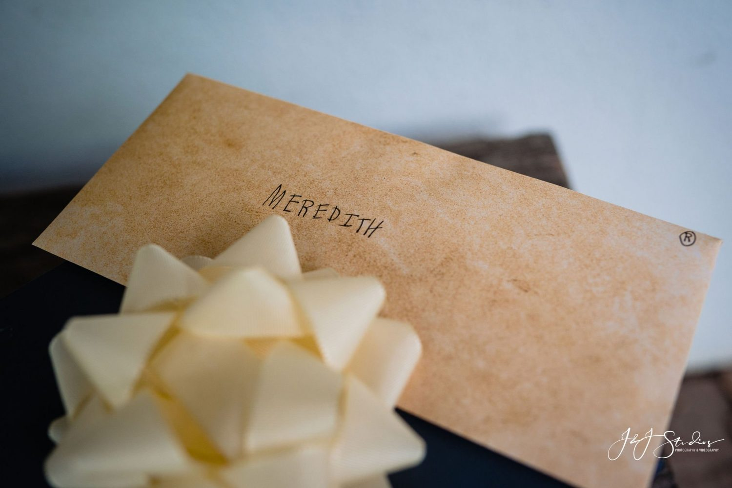 Meredith brown letter with bow