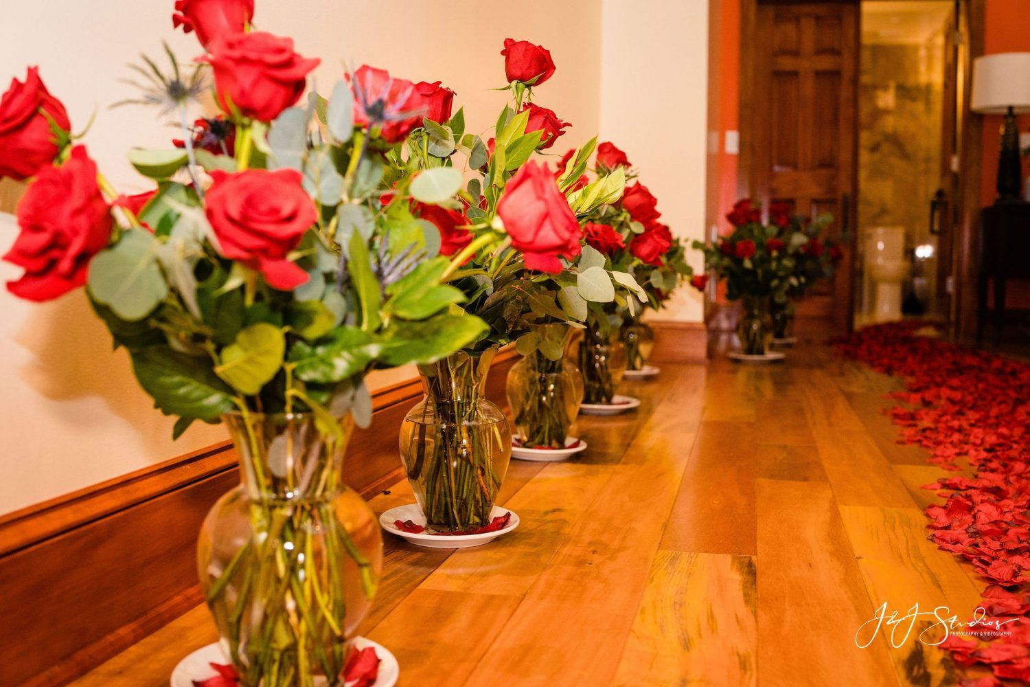 rose bouquets in vases on floor