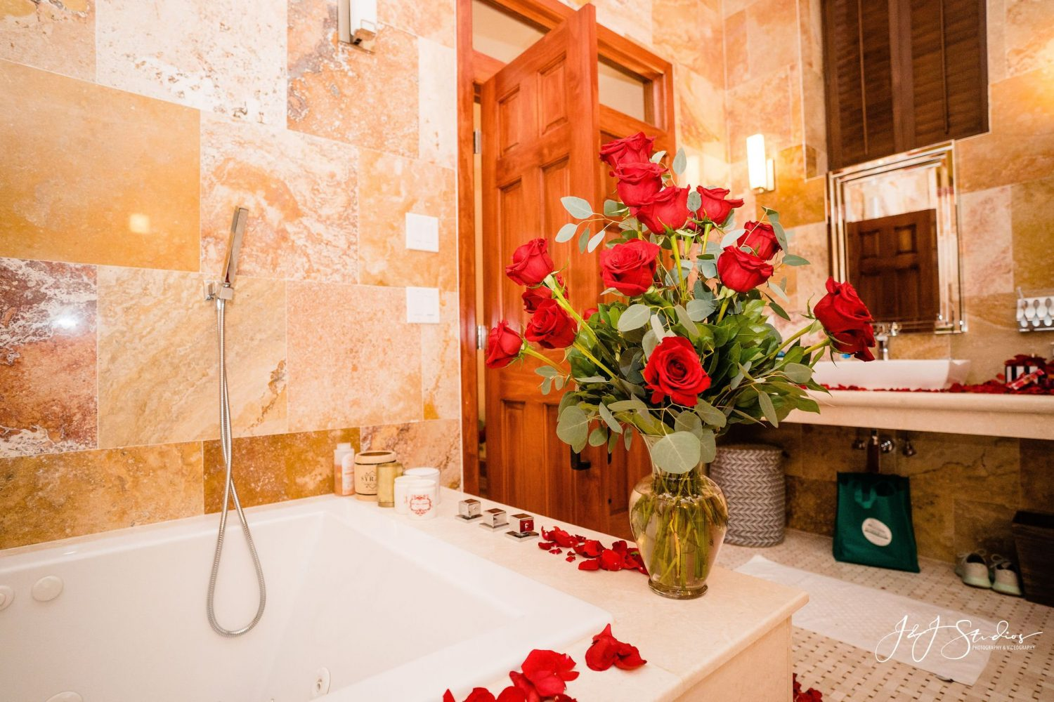 roses and rose petals in shower and bathtub