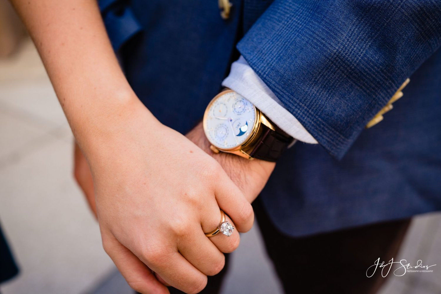 holding hands ring and nice watch