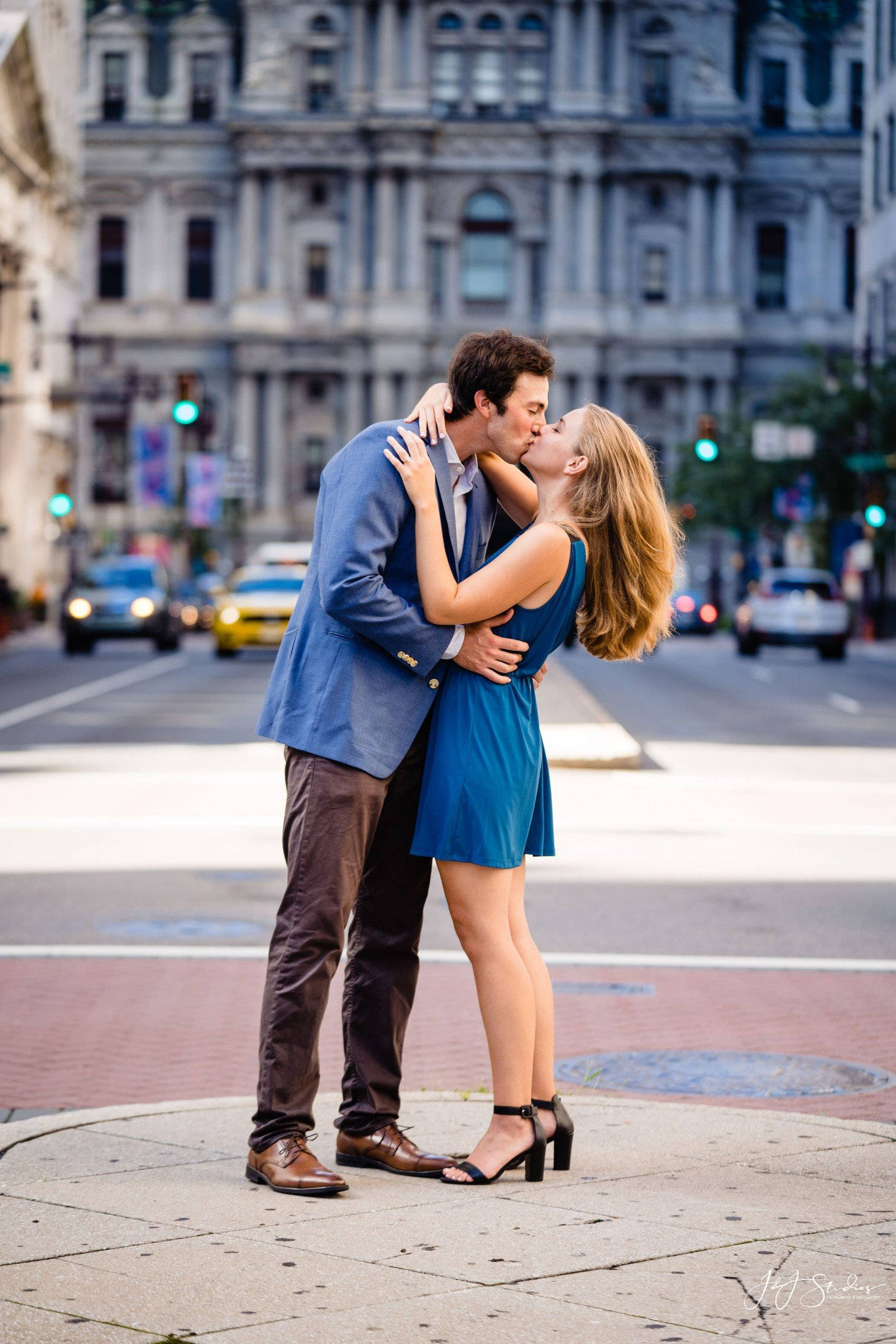 couple kissing girl in blue dress