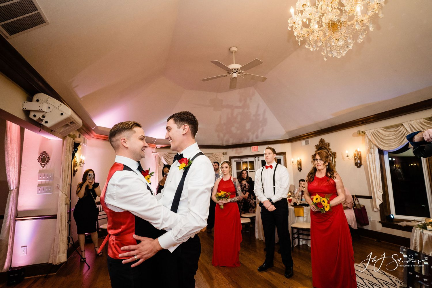 grooms dancing red and black wedding