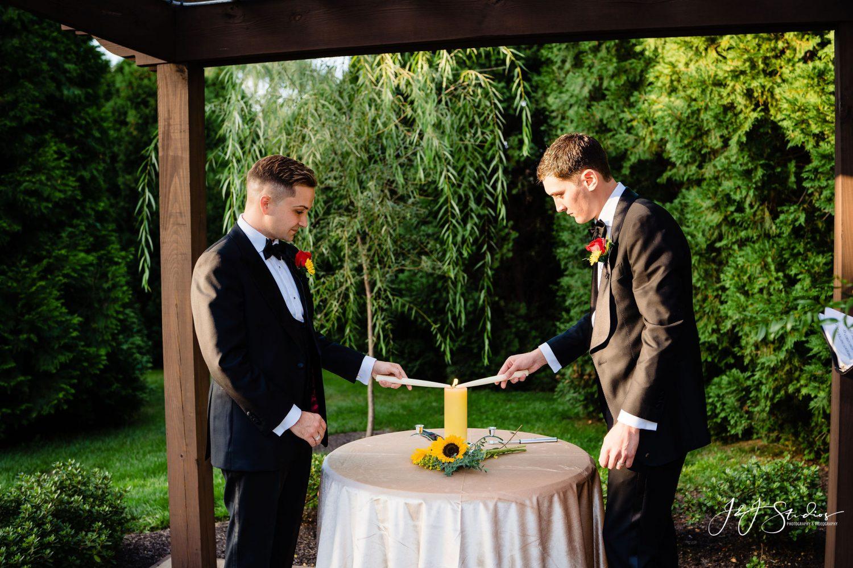 men lighting candles sunflower