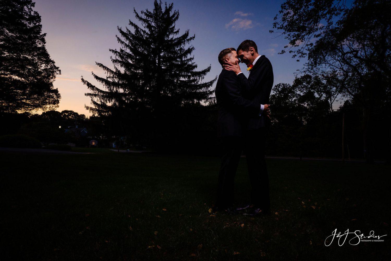 sunset photo newlywed grooms outside dark