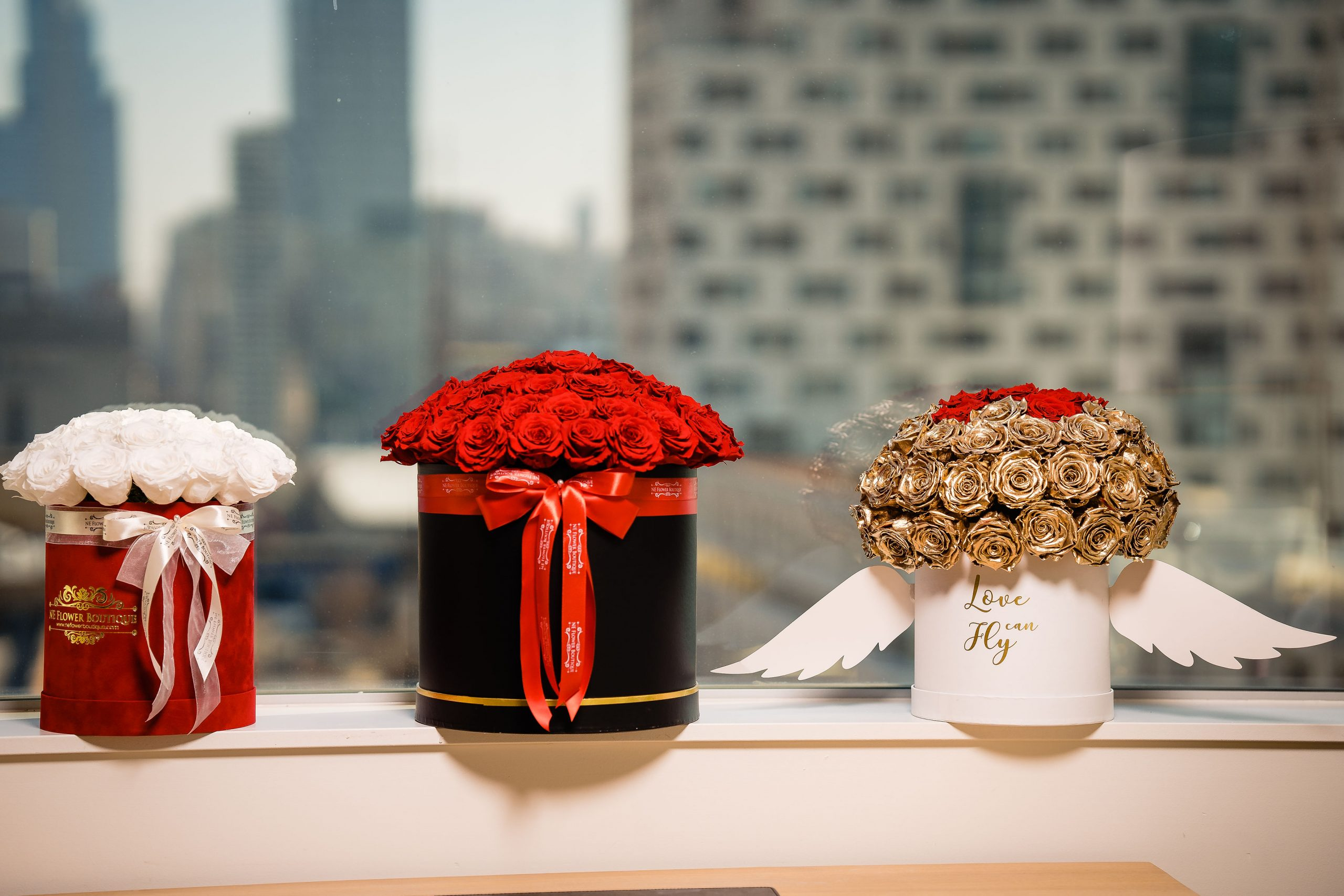 Red roses in the window sill