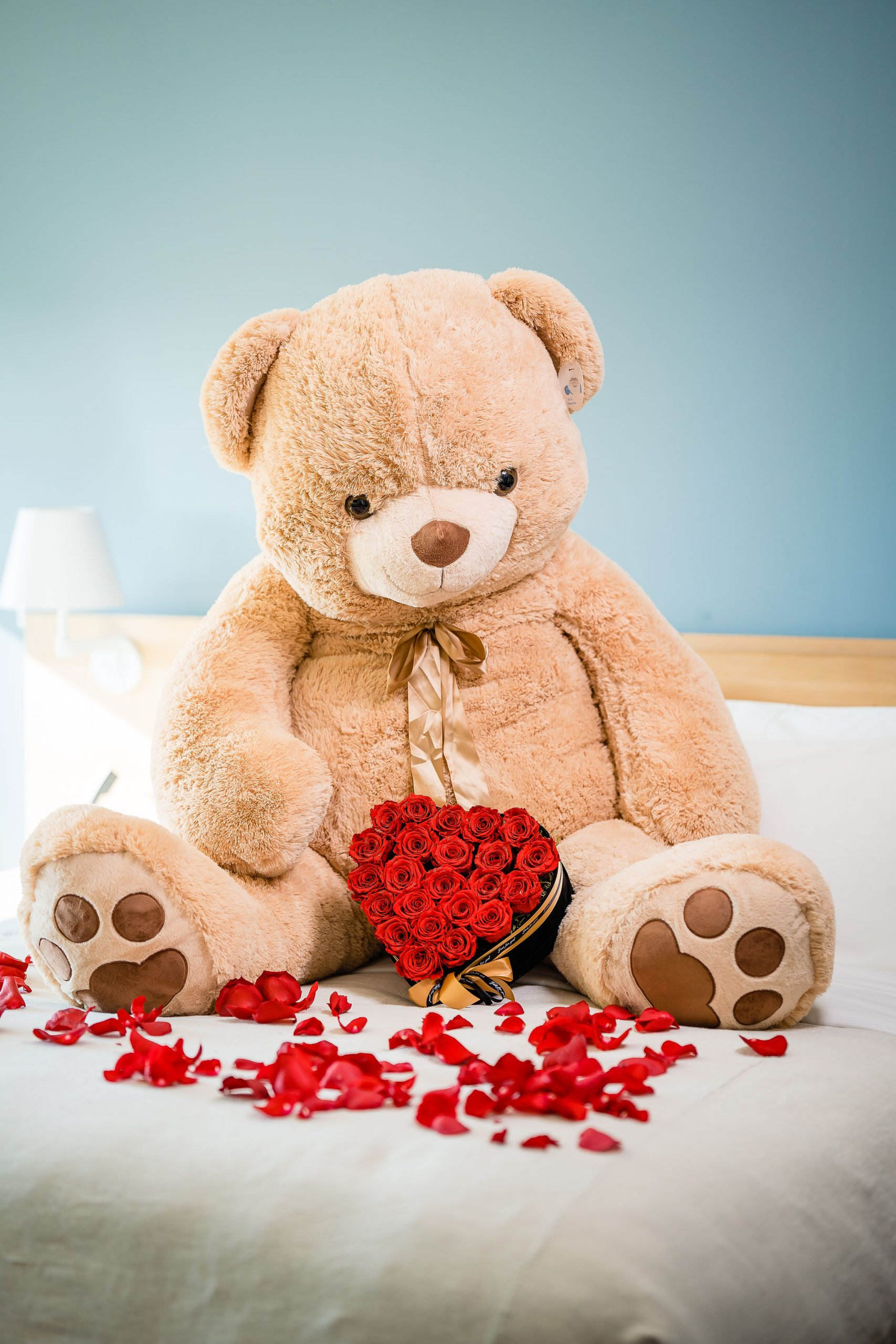 Cute teddy bear with roses styled flower boutique shoot