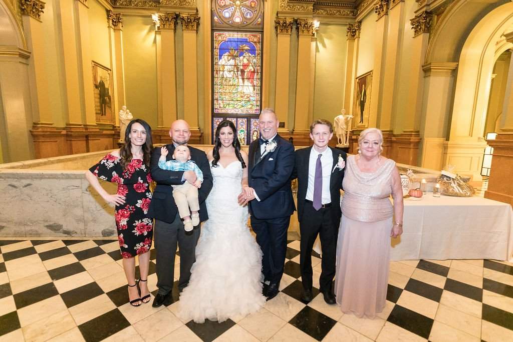 Wedding guests with bride and groom