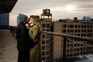 Couple rooftop kiss