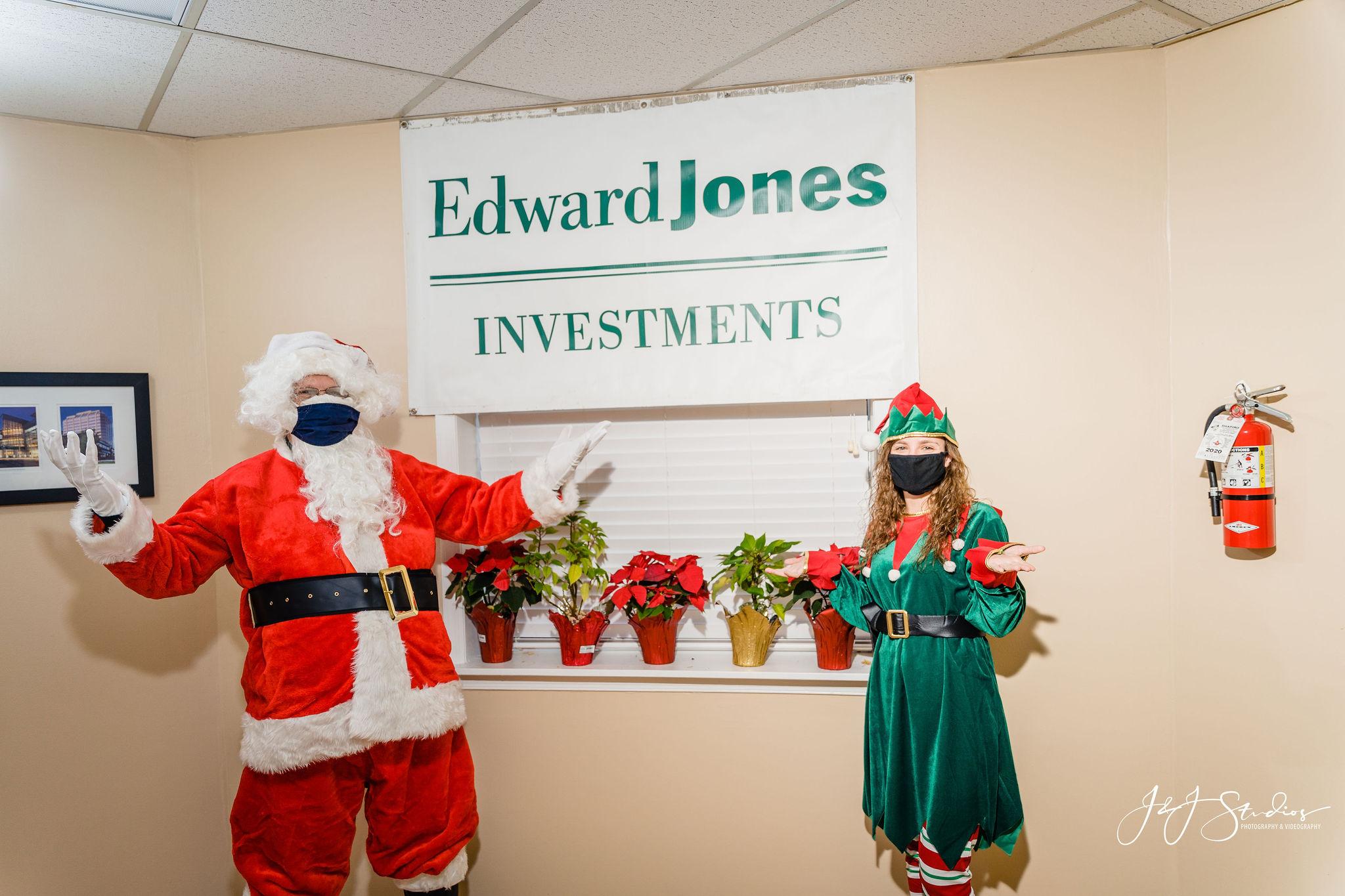 Santa and elf wear masks