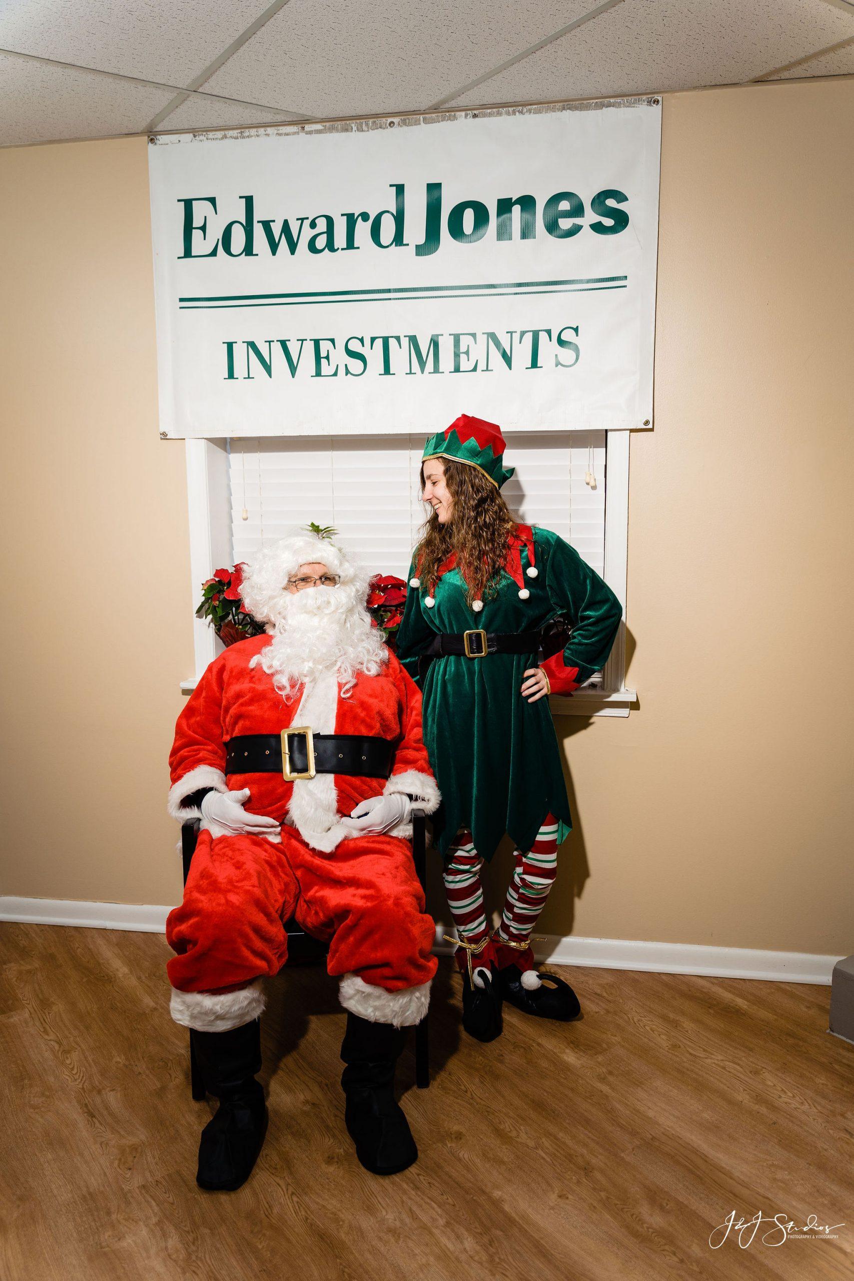 Santa sitting watch elf