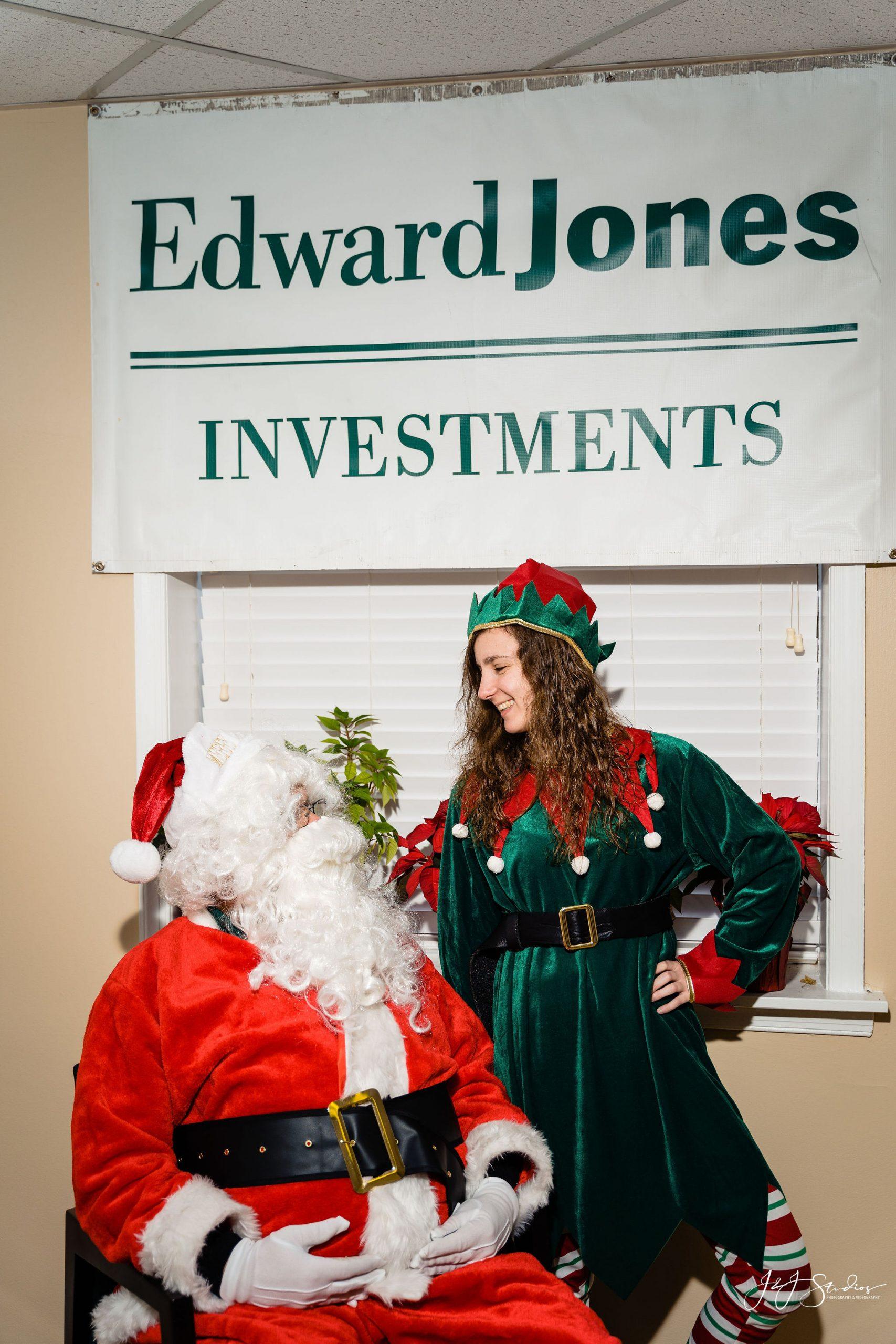 Elf looking at Santa Philadelphia Corporate holiday portraits