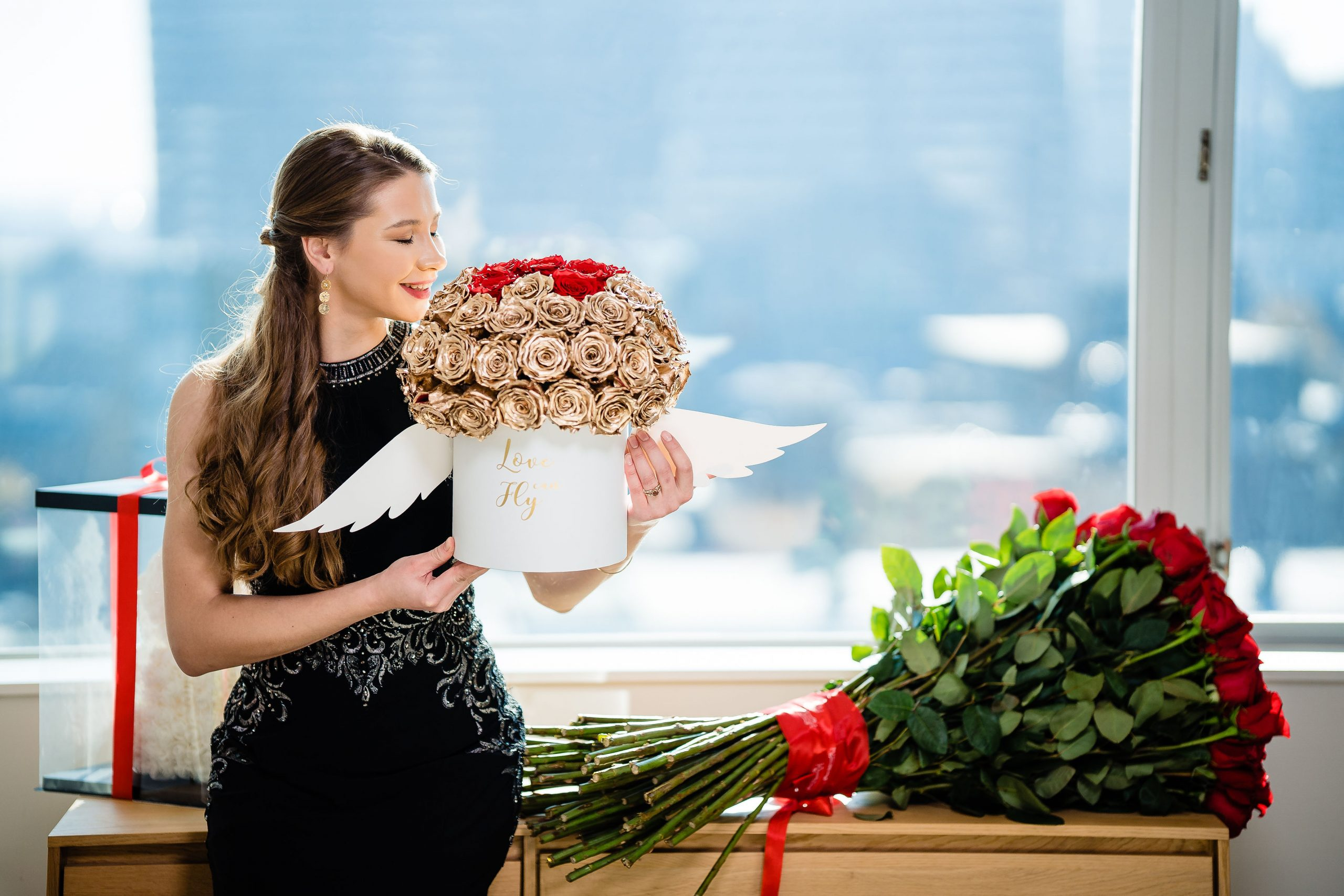Woman with bouquet of roses during styled flower boutique shoot