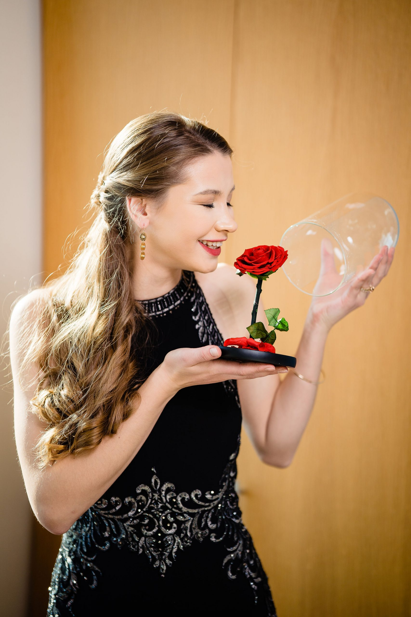 Happy woman receives rose