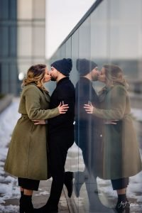 Beautiful couple kissing during Downtown Philadelphia engagement