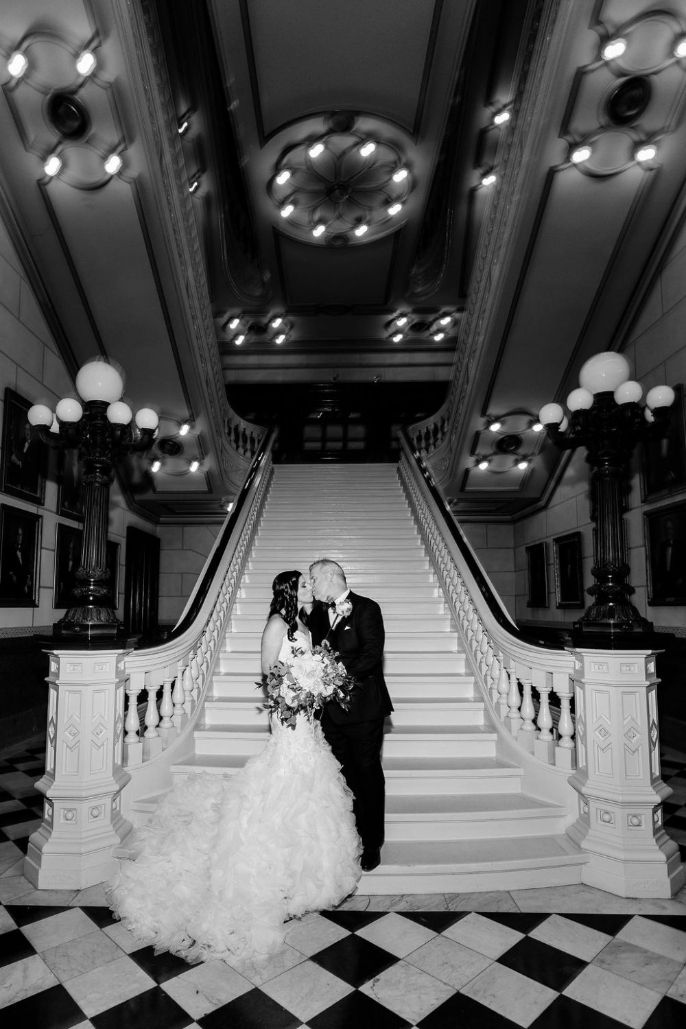 Loving bride and groom staircase One North Broad Wedding