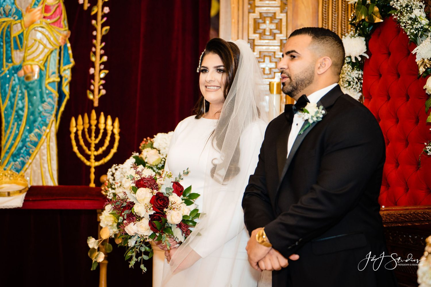Bride and Groom at the altar  Orthodox Wedding Session