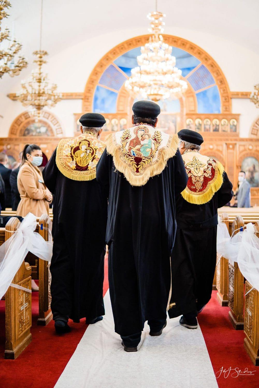 Men part of Greek wedding ceremony