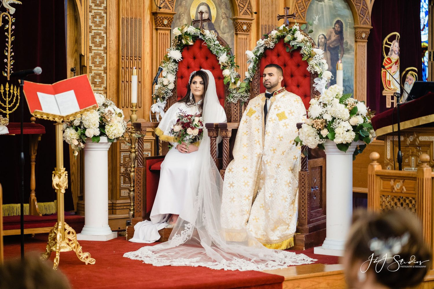 Bride and Groom sits on sacred throne during  Orthodox Wedding Session