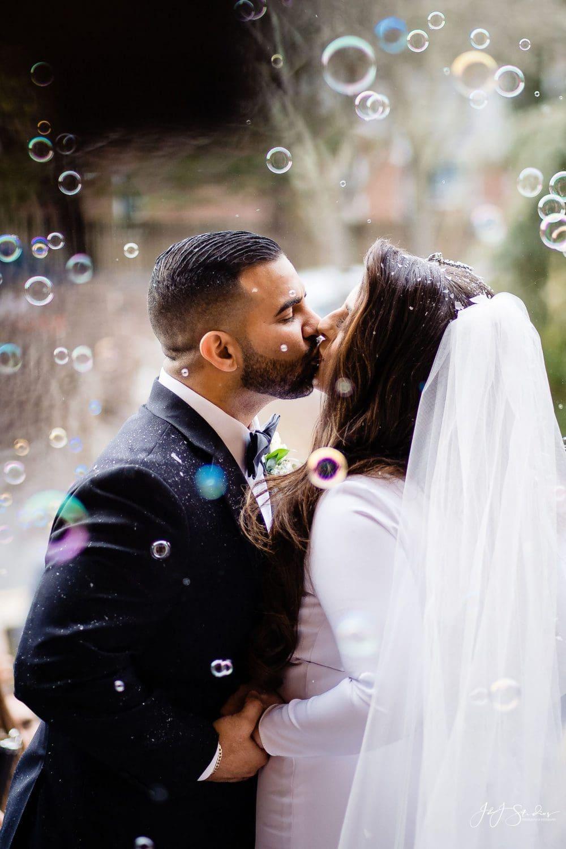 Romantic bride and groom kiss