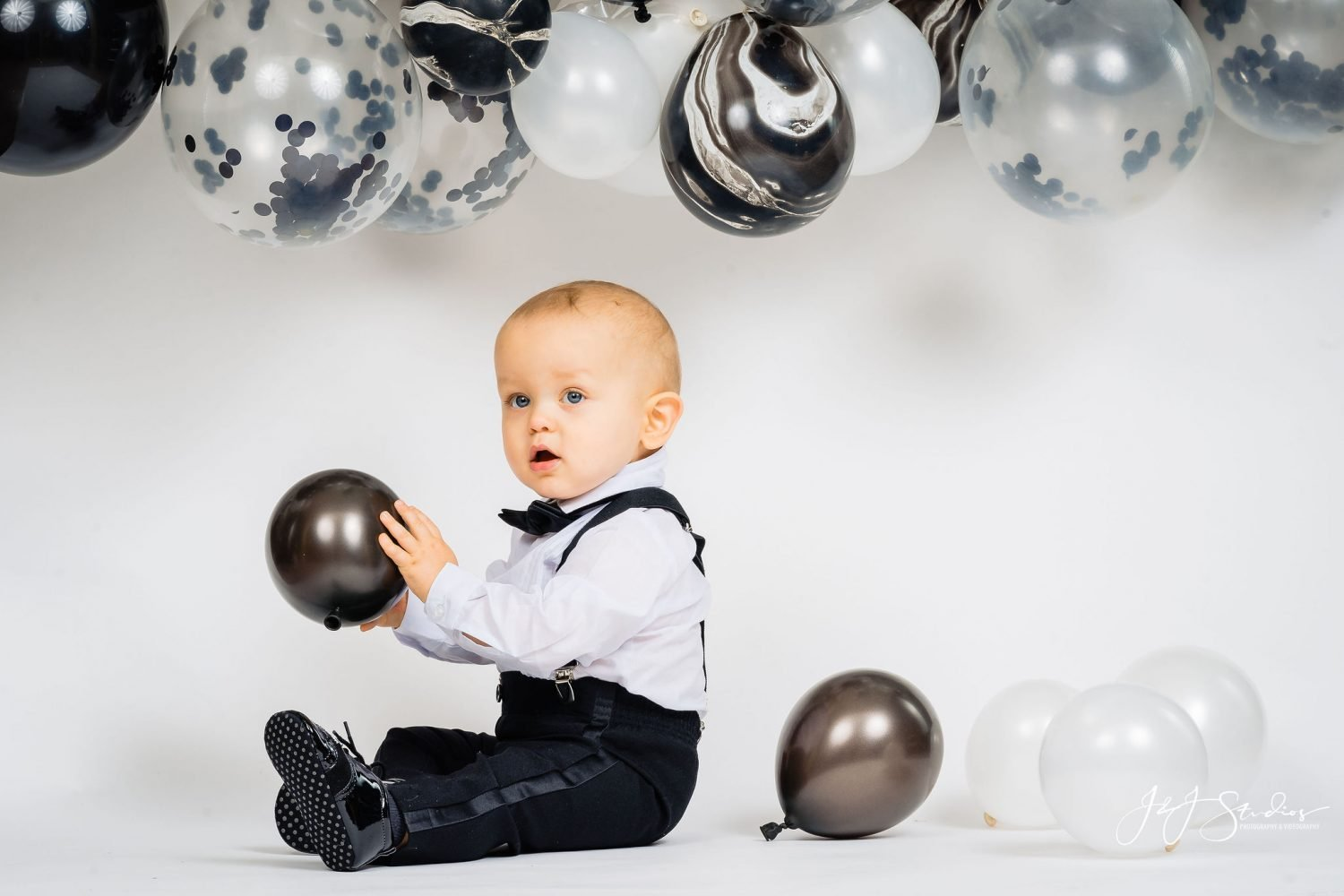 Cute baby playing with balloon