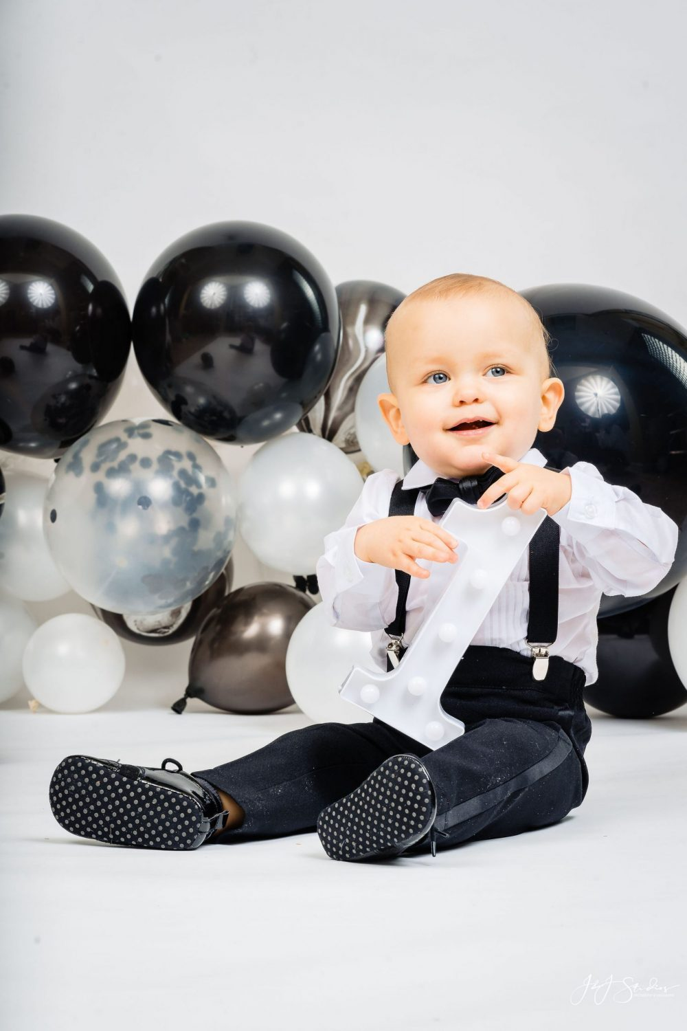 Adorable baby boy during First Birthday Cake Smash Session