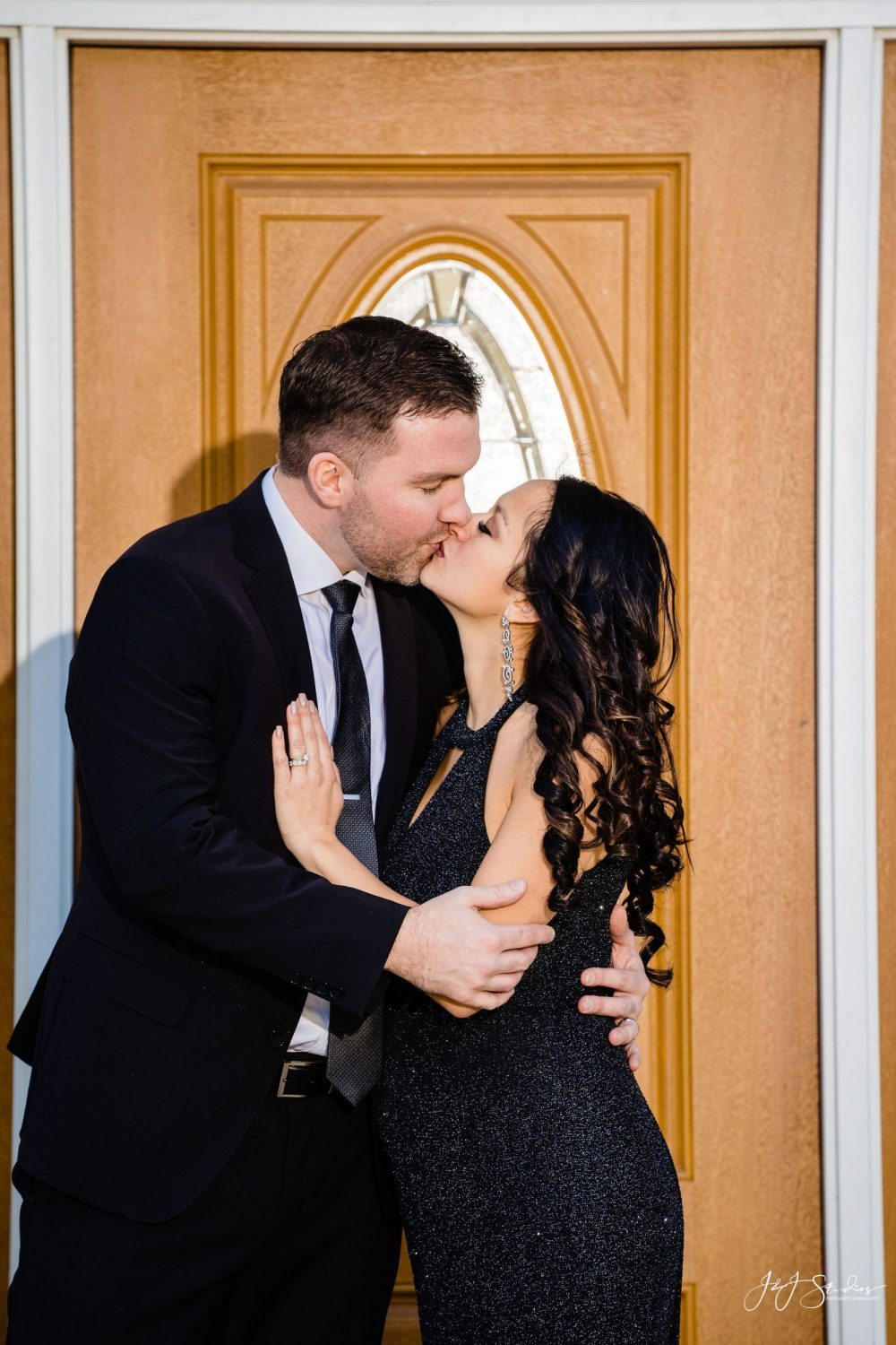 Lovely couple kissing during First Birthday Cake Smash Session