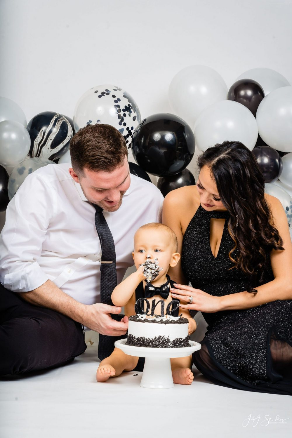 Parents with son during First Birthday Cake Smash Session