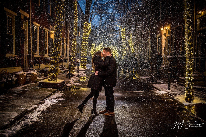 Couple kissing on street