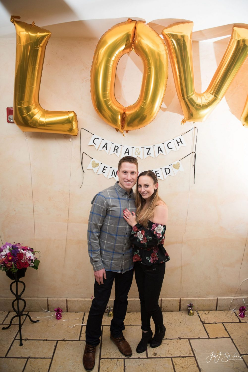 Happy couple during engagement party Christmas Proposal