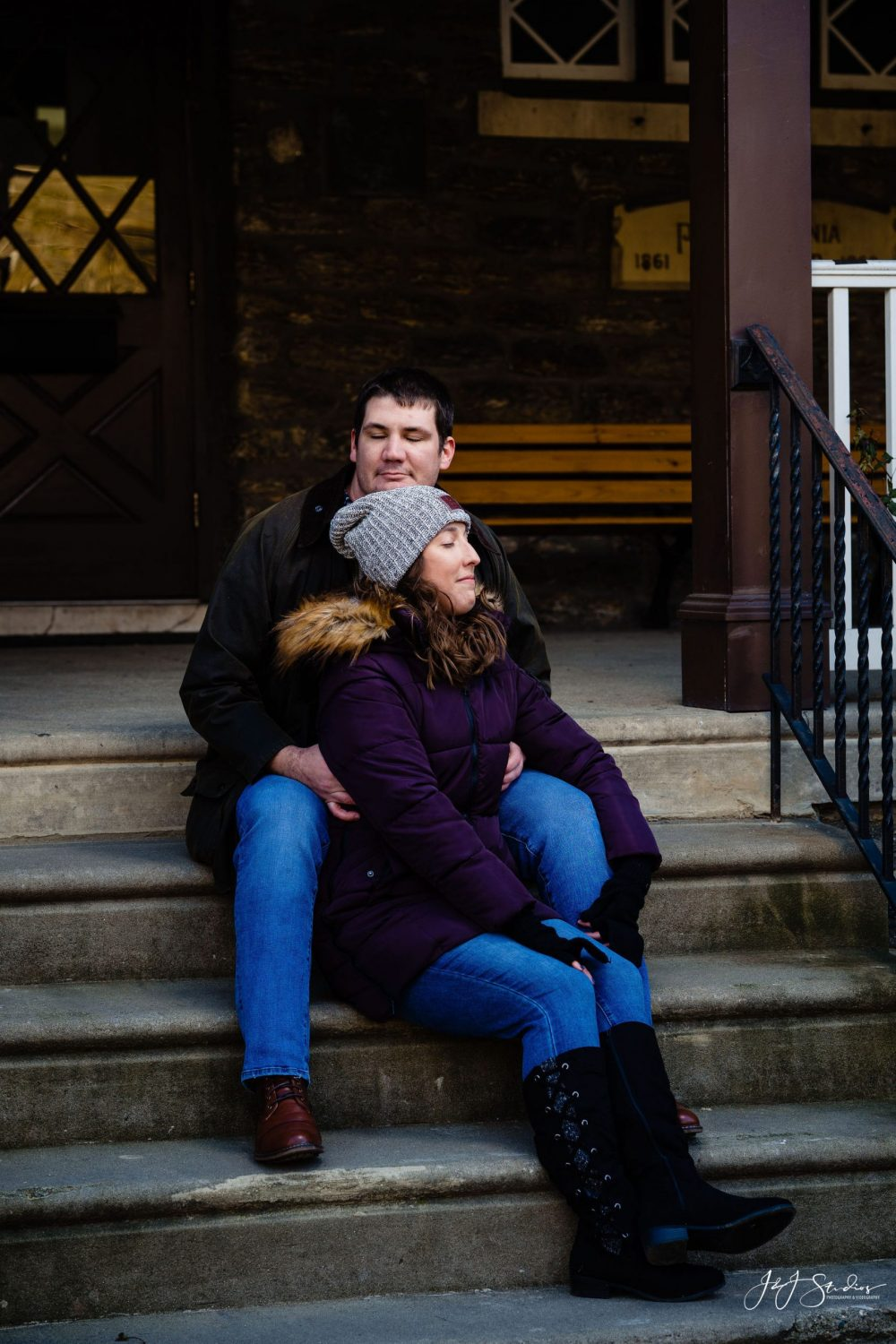 Couple sitting home steps Boathouse Row Engagement Session