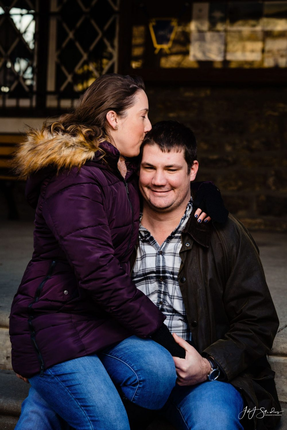 Lauren sitting on Brian's lap Boathouse Row Engagement Session