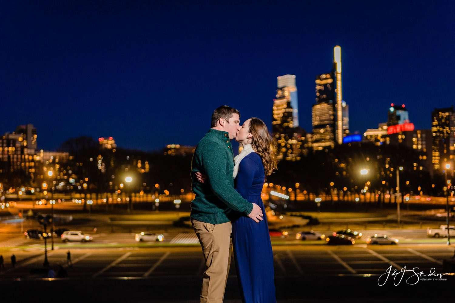 Kissing over the city Boathouse Row Engagement Session
