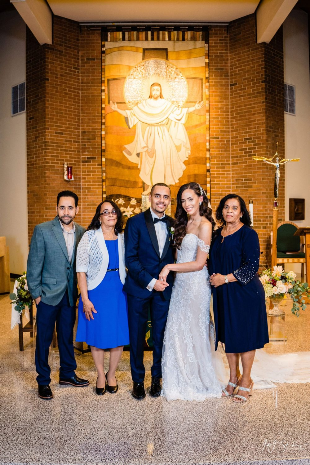 Bride and groom with family and friends