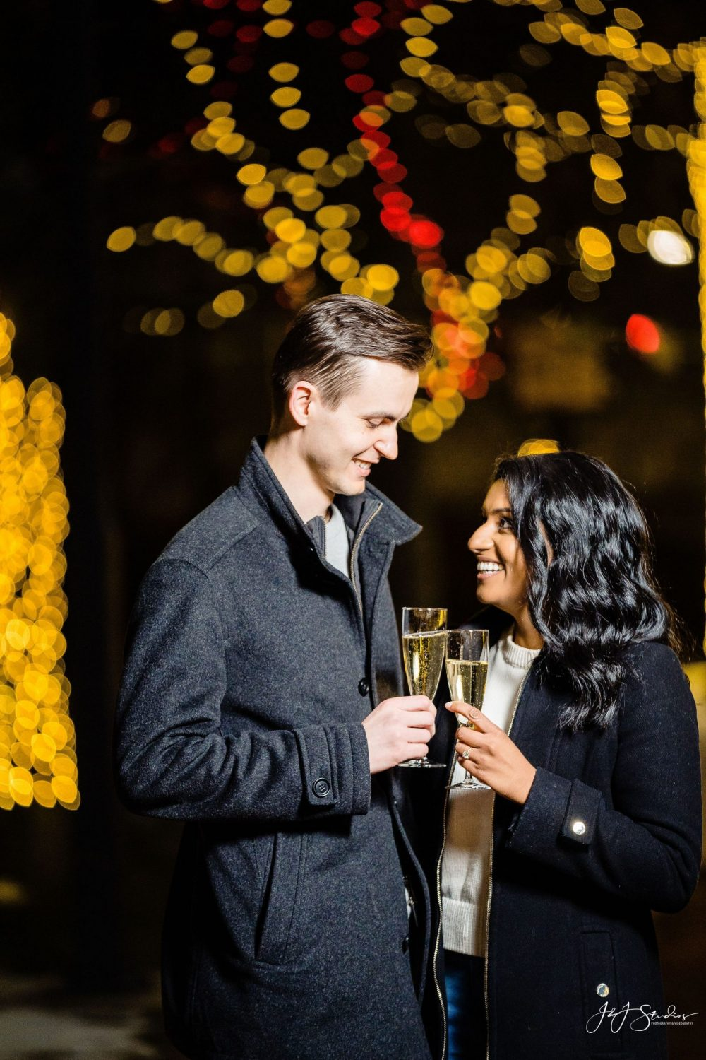 Engaged couple sharing bubbly Franklin Square Surprise Proposal