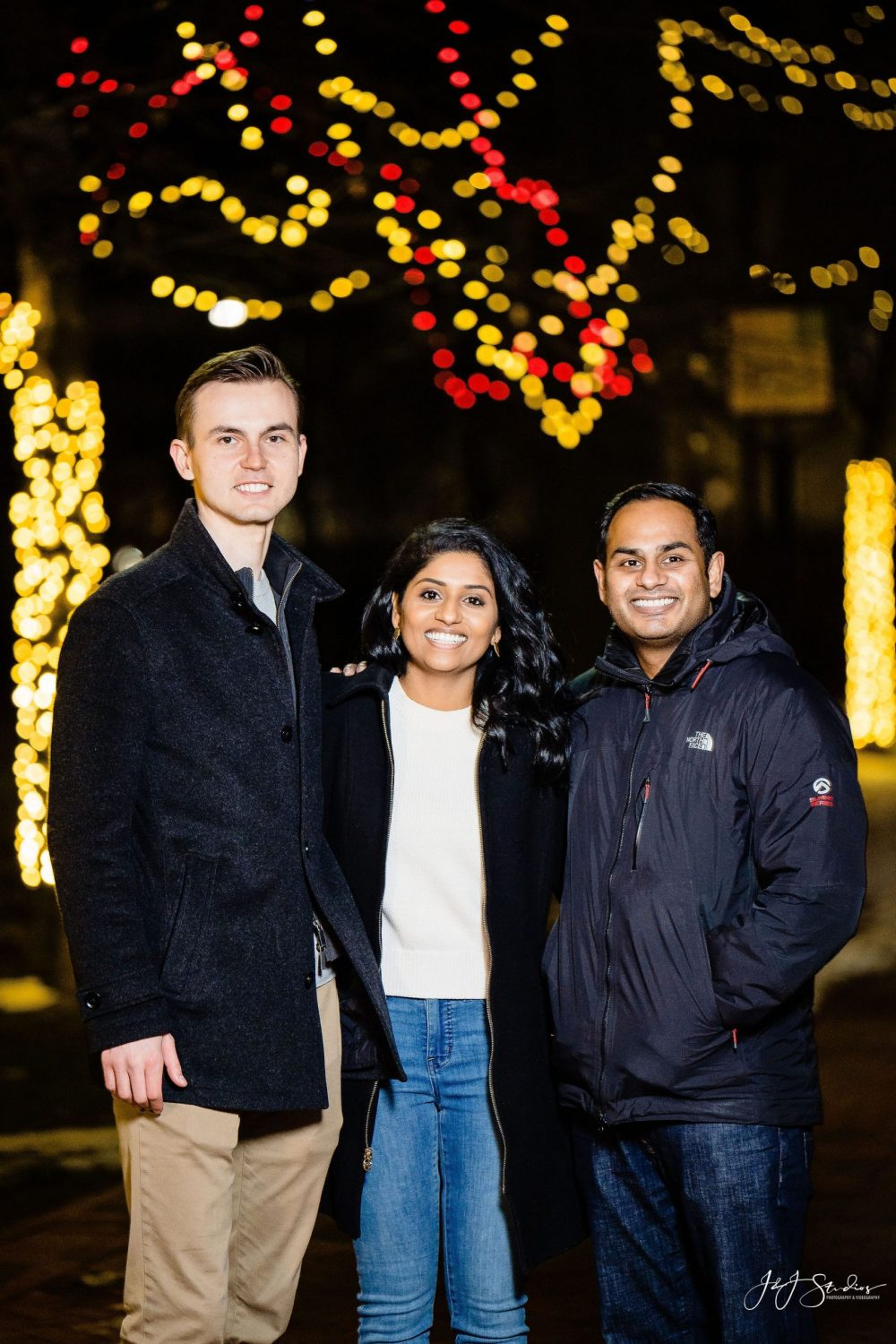 Engaged couple and fiance brother Franklin Square Surprise Proposal